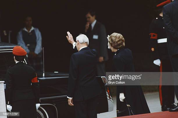 British Prime Minister Margaret Thatcher center right and her husband Denis Thatcher center left wave as US President Ronald Reagan and his wife and...