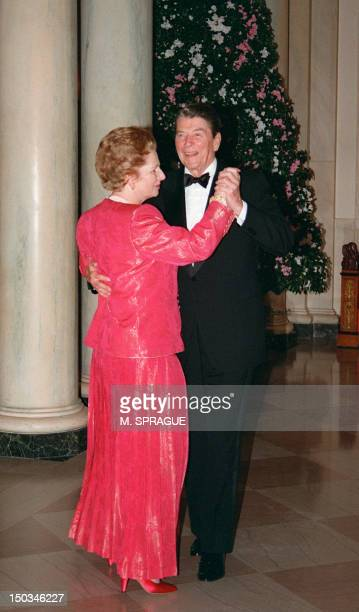British Prime Minister Margaret Thatcher dances with US President Ronald Reagan 16 November 1988 following a state dinner given in her honor at the...
