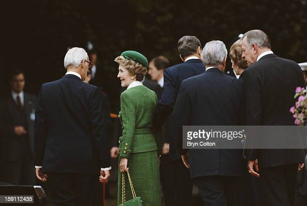 British Prime Minister Margaret Thatcher far right and her husband Denis Thatcher far left walk with US President Ronald Reagan and First Lady Nancy...