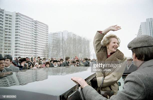 British Prime Minister Margaret Thatcher greets curious Moscovites who gathered to see her on March 29 1987 in Moscow during her official visit in...