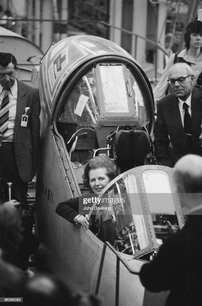 British Prime Minister Margaret Thatcher inspects a Sea Harrier aircraft, during a visit to the British Aerospace factory at Dunsfold, Surrey, 18th December 1982. She is accompanied by her husband Denis (1915 - 2003, right).