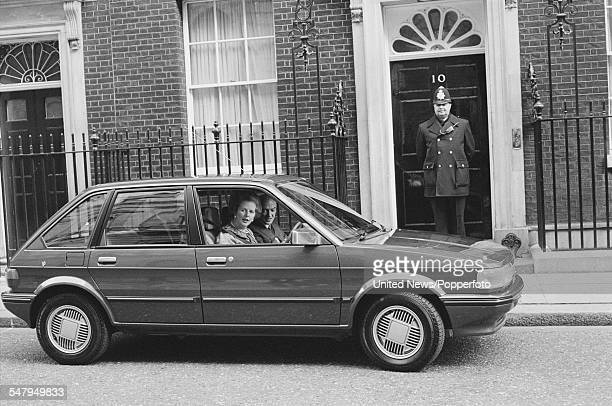 British Prime Minister Margaret Thatcher pictured sitting in the driver's seat of a newly launched British Leyland Austin Maestro car outside 10...