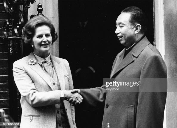 British Prime Minister Margaret Thatcher shaking hands with Hua Guofeng Chairman of the Communist Party of China outside 10 Downing Street London...