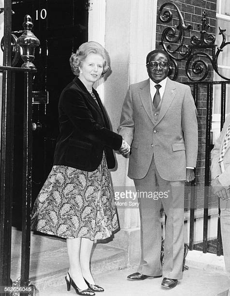 British Prime Minister Margaret Thatcher shaking hands with Zimbabwe Prime Minister Robert Mugabe outside 10 Downing Street London May 9th 1980