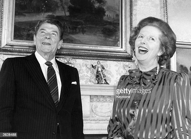 British Prime Minister Margaret Thatcher shares a joke with American President Ronald Reagan at No 10 Downing Street London