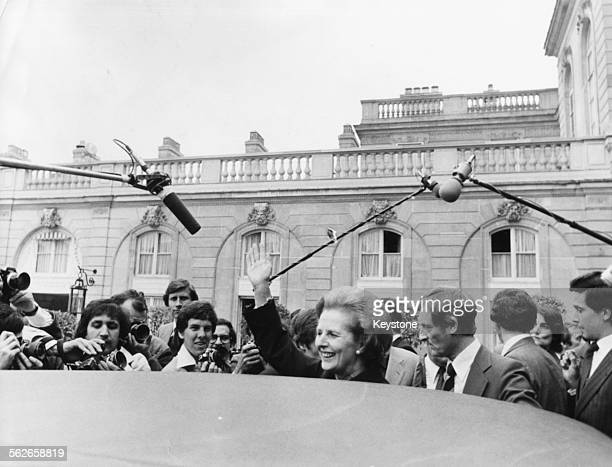 British Prime Minister Margaret Thatcher surrounded by press photographers as she leaves her car during a visit to France 1979