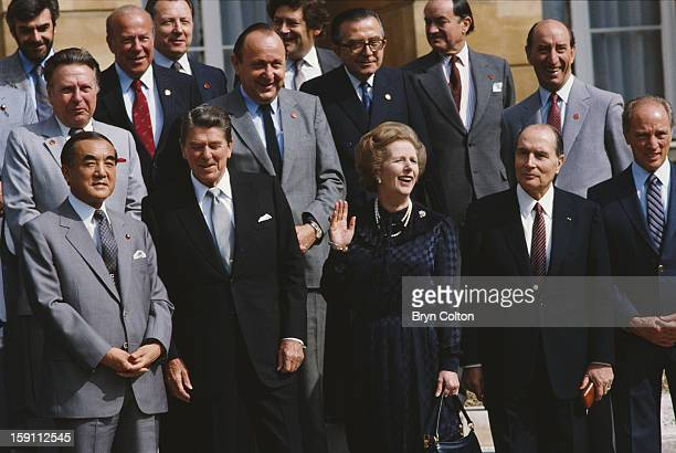 British Prime Minister Margaret Thatcher to questions from the media as she stands with world leaders at a photocall on the steps of Lancaster House...
