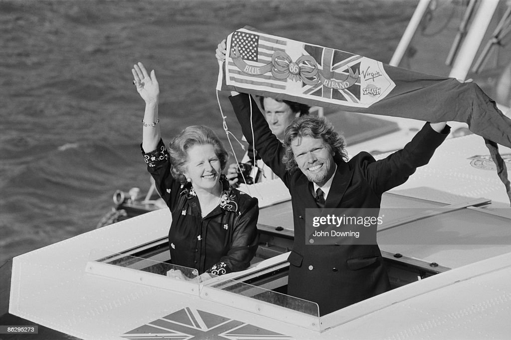 British Prime Minister Margaret Thatcher with businessman Richard Branson on his 72-foot powerboat Virgin Atlantic Challenger II, after his successful attempt at the record for the fastest Atlantic Ocean crossing, 4th July 1986.
