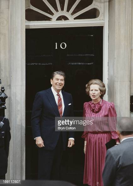 British Prime Minister Margaret Thatcher with US President Ronald Reagan on the steps of 10 Downing Street the day after the official start of the G7...