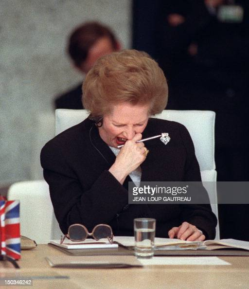 British Prime minister Margaret Thatcher yawns 19 November 1990 in Paris as she attends the Conference on Security and Cooperation in Europe