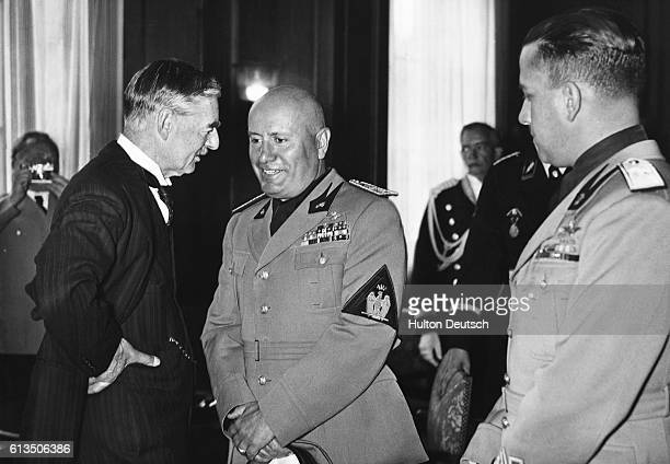 British Prime Minister Neville Chamberlain and Italian Dictator Benito Mussolini meet in Rome Galeazzo Ciano watches from the far right