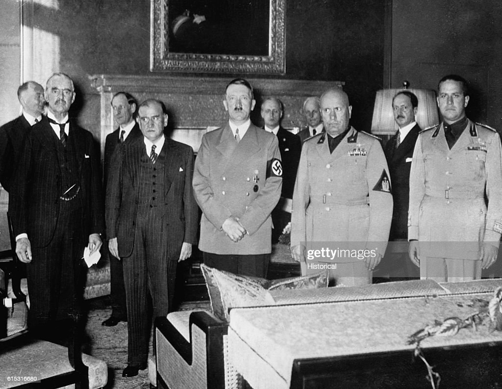 British Prime Minister Neville Chamberlain, French Premier Edouard Daladier, German Chancellor Adolf Hitler, Italian Prime Minister Benito Mussolini, and the Italian Foreign Minister, Count Galeazzo Ciano, (left to right) meet in Munich in October 1938.