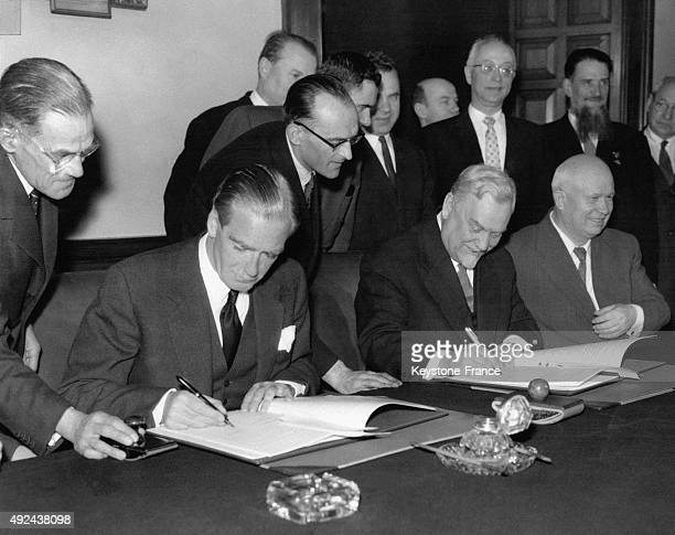 British Prime Minister Sir Anthony Eden Nikolai Bulganin and Nikita Khrushchev signing a RussianBritish statement at the Ministry of Foreign Affairs...