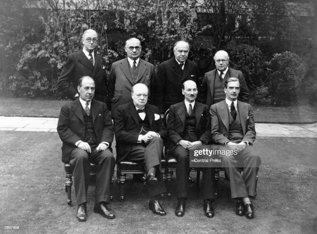British Prime Minister Sir Winston Churchill with the War Cabinet in 1941 from left to right seated Sir John Anderson Churchill Clement Attlee...