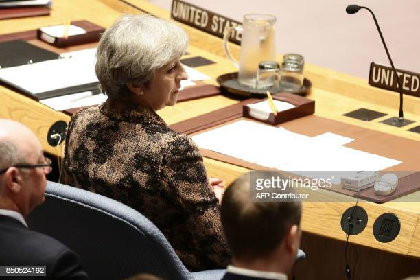 British Prime Minister Teresa May looks on as she participates in an open debate of the United Nations Security Council in New York on September 20...