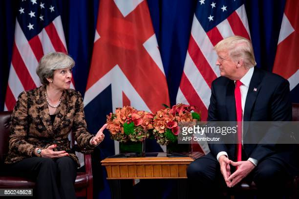 British Prime Minister Theresa May address the press as US President Donald Trump listens on during a meeting at the Palace Hotel in New York on the...