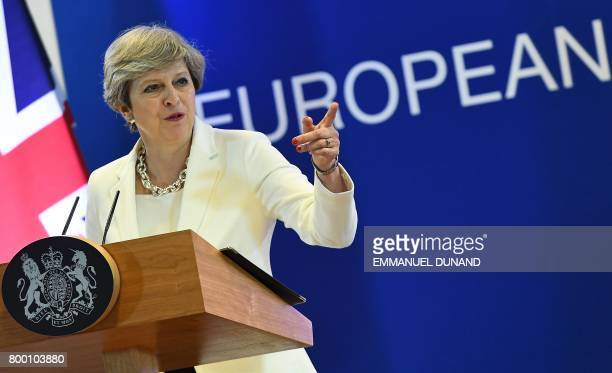 British Prime Minister Theresa May addresses a press conference at the end of a European Council meeting on the second day of a summit of European...