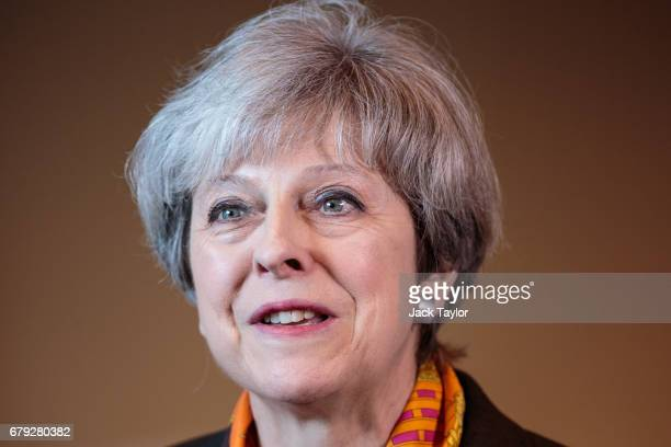 British Prime Minister Theresa May addresses the media following a tour of the Octink sign manufacturers' factory on May 5 2017 in Brentford England...
