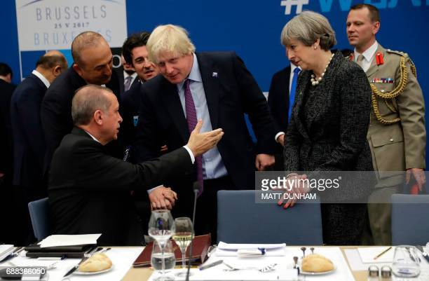 British Prime Minister Theresa May and British Foreign Minister Boris Johnson speak to Turkish President Recep Tayyip Erdogan during a working dinner...