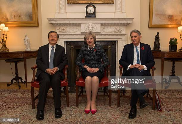 British Prime Minister Theresa May and Chancellor of the Exchequer Philip Hammond greet China's Vice Premier Ma Kai as he arrives in 10 Downing...