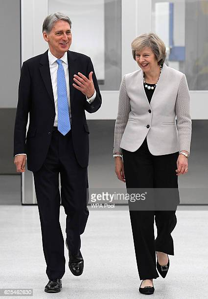 British Prime Minister Theresa May and Chancellor of the Exchequer Philip Hammond tour the Renishaw innovation and engineering plant on November 24...