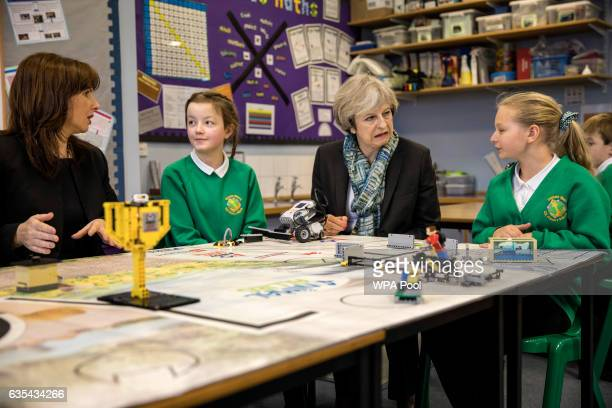 British Prime Minister Theresa May and Conservative Party candidate for the upcoming Copeland byelection Trudy Harrison sit with year six pupils...