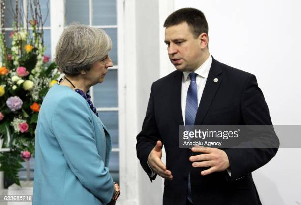 British Prime Minister Theresa May and Estonia's Prime Minister Juri Ratas chat during an informal European Union summit with the attendance of...