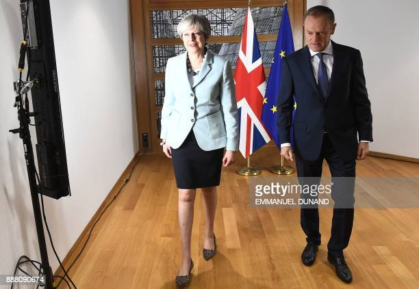British Prime Minister Theresa May and European Council President Donald Tusk leave after posing for photographers at the European Council in...
