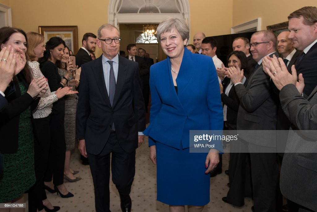 British Prime Minister Theresa May and her husband Philip are clapped into 10 Downing Street in by staff after returning from seeing Queen Elizabeth II at Buckingham Palace on June 9, 2017 in London, United Kingdom. After a snap election was called by Prime Minister Theresa May the United Kingdom went to the polls yesterday. The closely fought election has failed to return a clear overall majority winner and Theresa May has formed a minority Government with the support of Northern Ireland's Democratic Unionist Party.