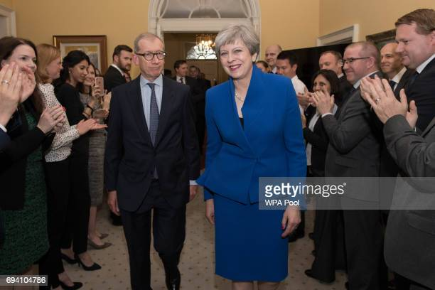 British Prime Minister Theresa May and her husband Philip are clapped into 10 Downing Street in by staff after returning from seeing Queen Elizabeth...