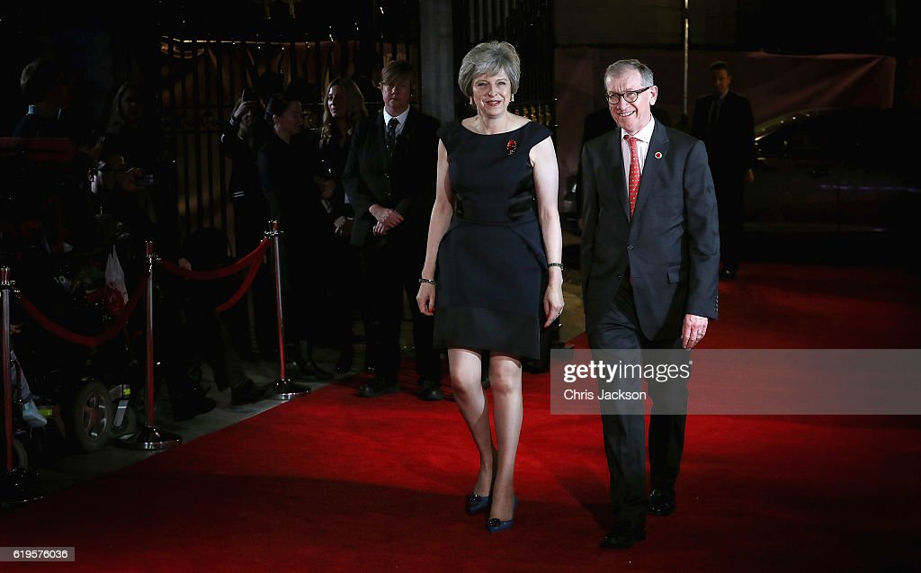 British Prime Minister Theresa May and her husband Philip John May attend the Pride Of Britain awards at the Grosvenor House Hotel on October 31, 2016 in London, England.