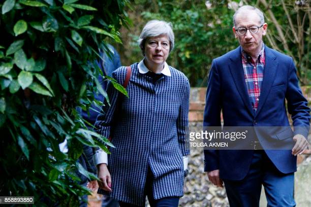 British Prime Minister Theresa May and her husband Philip May arrive to attend the Sunday morning service at a church in her Maidenhead constituency...
