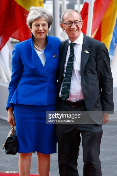 British Prime Minister Theresa May and her husband Philip May arrives to attend a concert at the Elbphilharmonie philharmonic concert hall on the...
