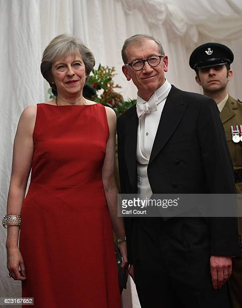 British Prime Minister Theresa May and her husband Philip May attend the Lord Mayor's Banquet at Guildhall on November 14 2016 in London England The...
