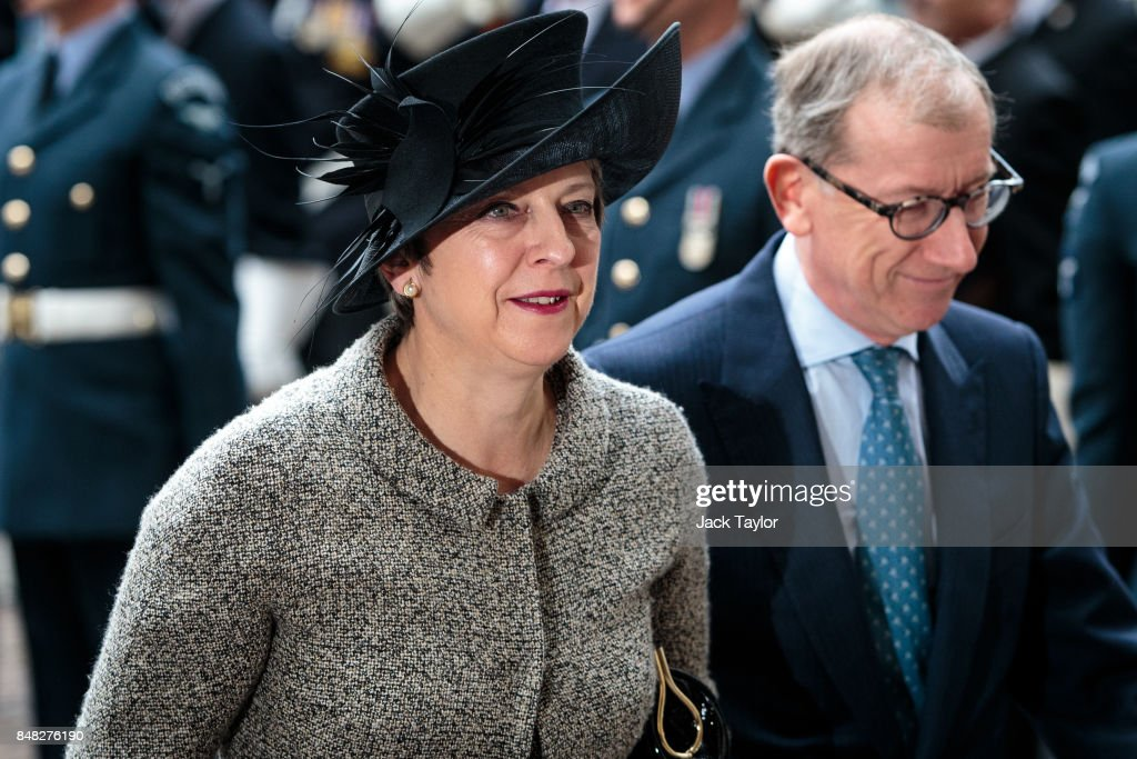 British Prime Minister Theresa May and her husband Philip May attend a service to mark the 77th anniversary of the Battle of Britain at Westminster Abbey on September 17, 2017 in London, England. The annual service remembers the pilots and aircrew of the Royal Air Force who lost their lives in the 1940 Battle of Britain during World War II.