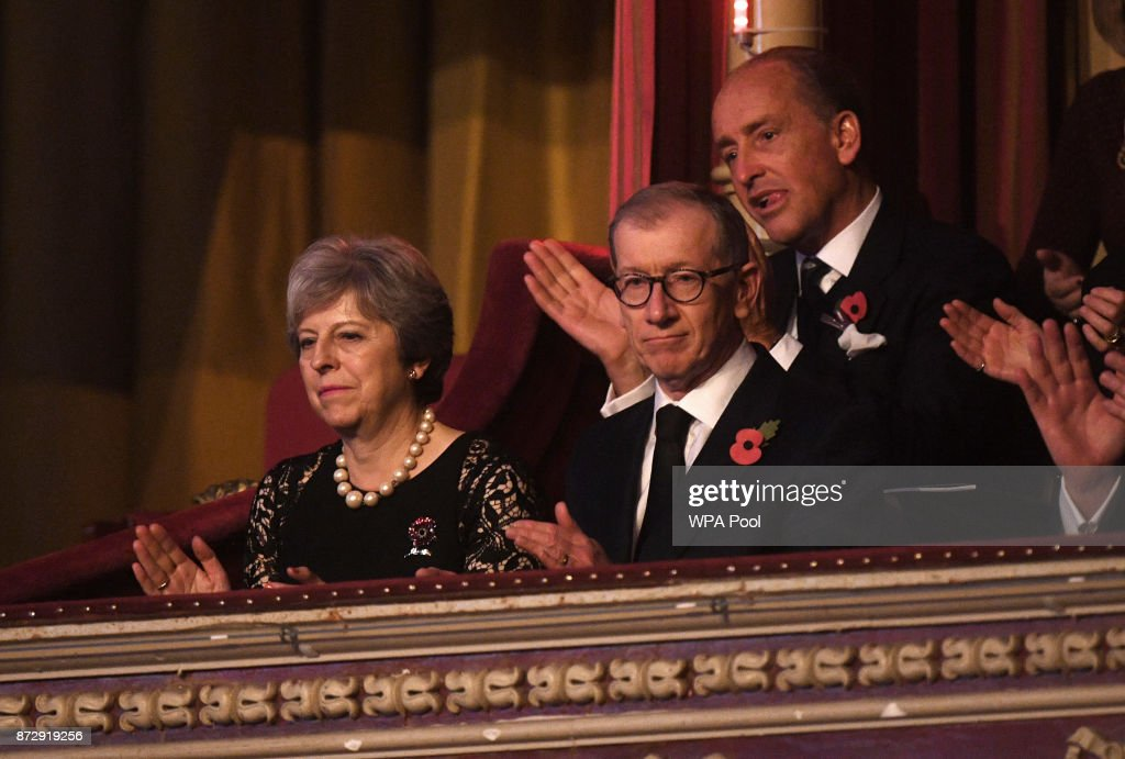 British Prime Minister Theresa May and her husband Philip May attend the annual Royal Festival of Remembrance to commemorate all those who have lost their lives in conflicts at the Royal Albert Hall on November 11, 2017 in London, England.