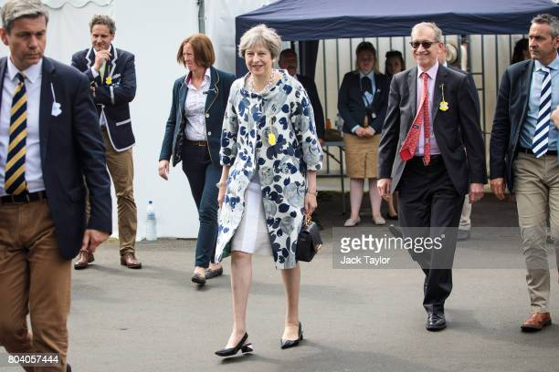 British Prime Minister Theresa May and her husband Philip May leave the Stewards' Enclosure at the Henley Royal Regatta on June 30 2017 in...