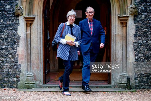 TOPSHOT British Prime Minister Theresa May and her husband Philip May leave after attending the Sunday morning service at a church in her Maidenhead...