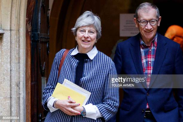 British Prime Minister Theresa May and her husband Philip May leave after attending the Sunday morning service at a church in her Maidenhead...