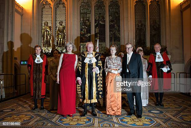 British Prime Minister Theresa May and her husband Philip May pose for a photograph with the Lord Mayor of London Andrew Parmley and his wife Wendy...