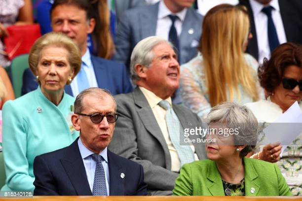British Prime Minister Theresa May and husband Philip look on from the centre court royal box prior to the Gentlemen's Singles final between Roger...