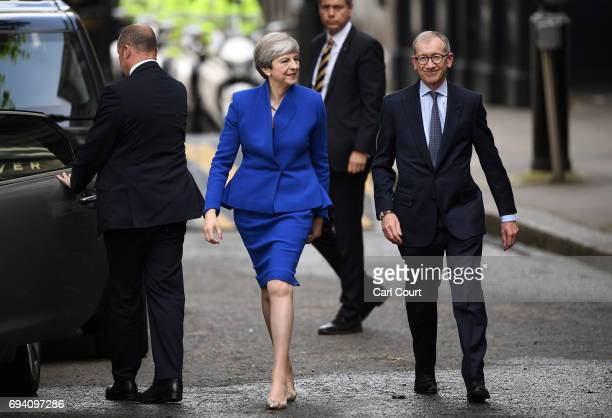 British Prime Minister Theresa May and husband Philip May arrive at 10 Downing Street after returning from Buckingham Palace on June 9 2017 in London...