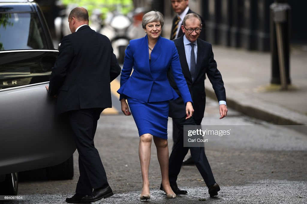 British Prime Minister Theresa May and husband Philip May arrive at 10 Downing Street after returning from Buckingham Palace on June 9, 2017 in London, United Kingdom. After a snap election was called by Prime Minister Theresa May the United Kingdom went to the polls yesterday. The closely fought election has failed to return a clear overall majority winner and a hung parliament has been declared.