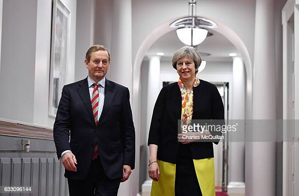 British Prime Minister Theresa May and Irish Taoiseach Enda Kenny make their way to a joint press conference at Government Buildings on January 30...
