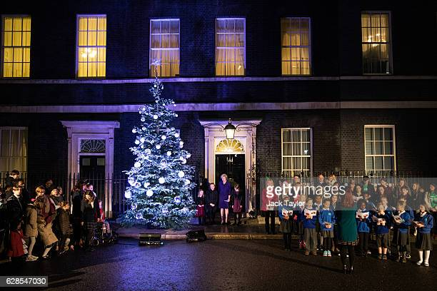 British Prime Minister Theresa May and Isabel Milns Jade Winsor and Sophie Brazil from schools in Maidenhead switch on the Christmas tree lights...
