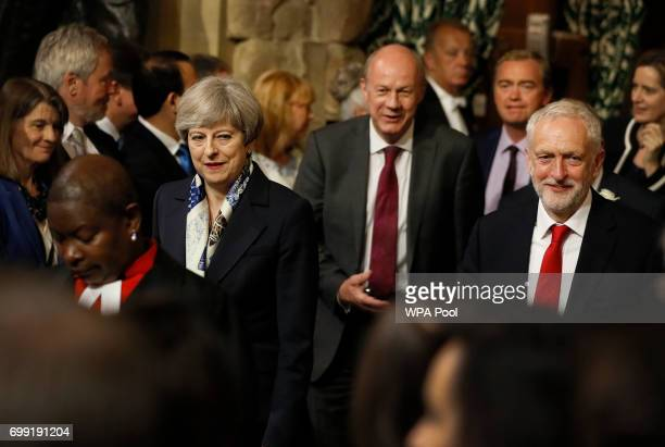 British Prime Minister Theresa May and Leader of the Labour Party Jeremy Corbyn walk through the House of Commons to attend the the State Opening of...