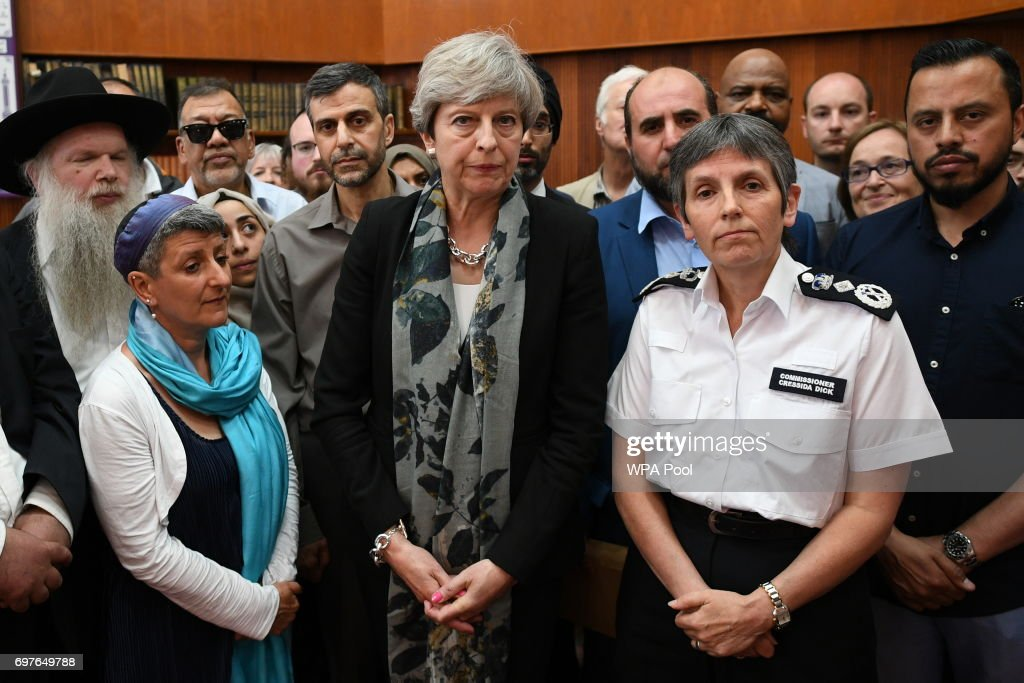 British Prime Minister Theresa May and Metropolitan Police Commissioner Cressida Dick talk to faith leaders at Finsbury Park Mosque on June 19, 2017 in London, England. Worshippers were struck by a hired van as they were leaving Finsbury Park mosque in North London after Ramadan prayers. One person was killed in the terror attack with a further 10 people injured.