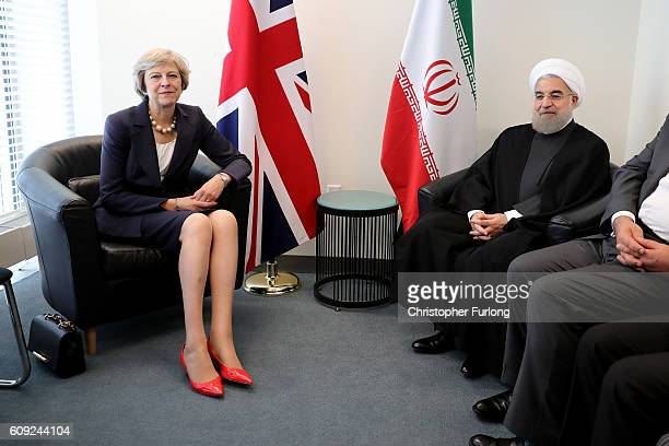 British Prime Minister Theresa May and the President of Iran Hassan Rouhani pose as they meet before a bilateral meeting during the United Nations...
