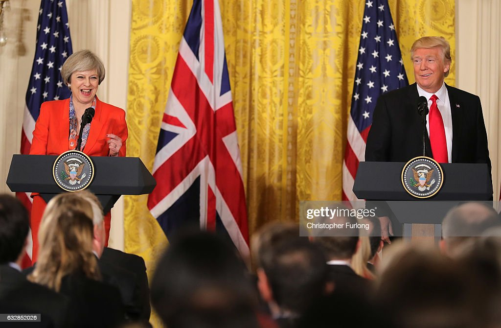 British Prime Minister Theresa May and U.S. President Donald Trump smile during a joint press conference in The East Room at The White House on January 27, 2017 in Washington, DC. British Prime Minister Theresa May is on a two-day visit to the United States and will be the first world leader to meet with President Donald Trump.