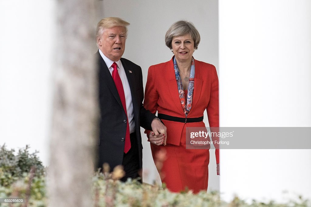 British Prime Minister Theresa May and U.S. President Donald Trump walk along The Colonnade of the West Wing at The White House on January 27, 2017 in Washington, DC. British Prime Minister Theresa May is on a two-day visit to the United States and will be the first world leader to meet with President Donald Trump.